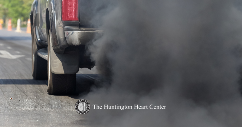 Exhaust from vehicle clouds the air. Representing air pollution and negative health effects on the heart. The Huntington Heart Center logo at bottom center.